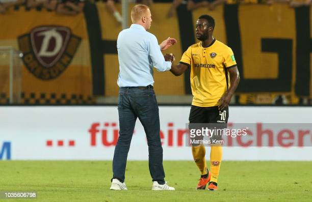 Head coach Maik Walpurgis of Dresden ans Erich Berko look on after the Second Bundesliga match between SG Dynamo Dresden and Hamburger SV at...