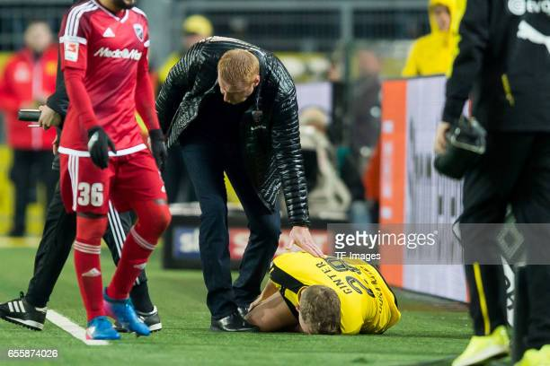 Head coach Maik Walpurgis of Ingolstadt bei Matthias Ginter of Dortmund on the ground during the Bundesliga match between Borussia Dortmund and FC...