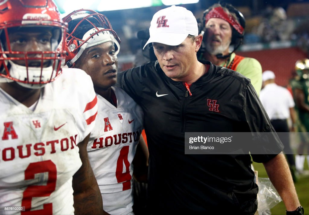 Head coach Major Applewhite hugs quarterback D'Eriq King #4 as they celebrate their 28-24 win over the South Florida Bulls at an NCAA football game on October 28, 2017 at Raymond James Stadium in Tampa, Florida.