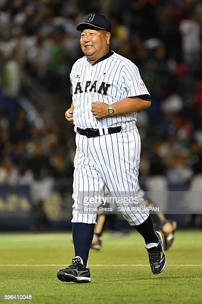 Head Coach Mamoru Koeda of U-18 Japan looks on in the top half of the sixth inning during in the send-off game between U-18 Japan and Collegiate...