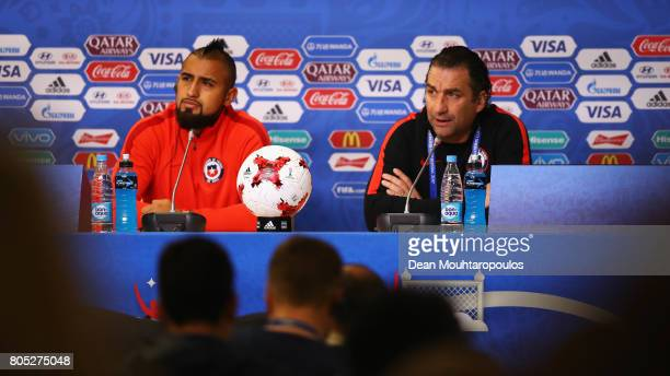 Head Coach / Manager Juan Antonio Pizzi and Arturo Vidal of Chile speaks to the media during a press conference of the Chiliean national football...