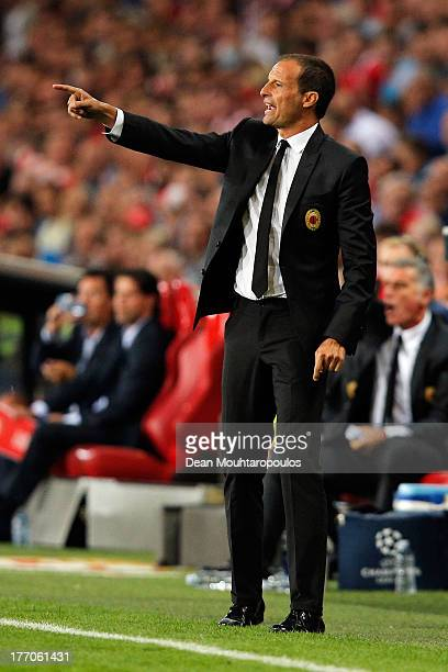 Head coach / Manager Massimiliano Allegri of AC Milan gives his team instructions during the UEFA Champions League Playoff First Leg match between...