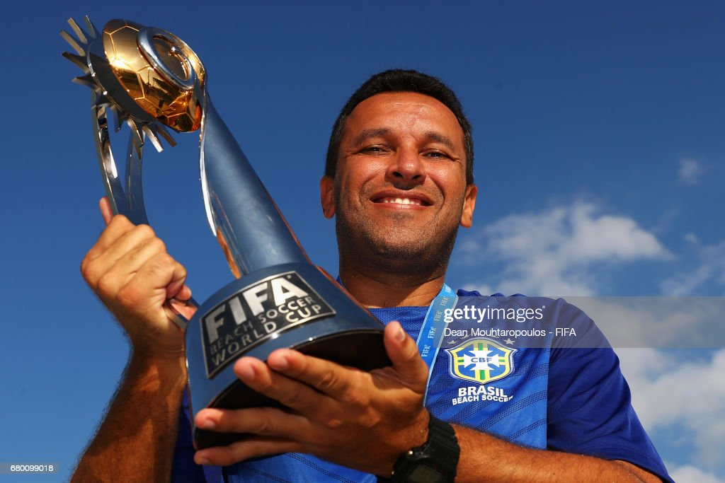 Head coach / Manager of Brazil, Gilberto Sousa poses with the winning trophy after victory in the FIFA Beach Soccer World Cup Bahamas 2017 final between Tahiti and Brazil at National Beach Soccer Arena at Malcolm Park on May 7, 2017 in Nassau, Bahamas.