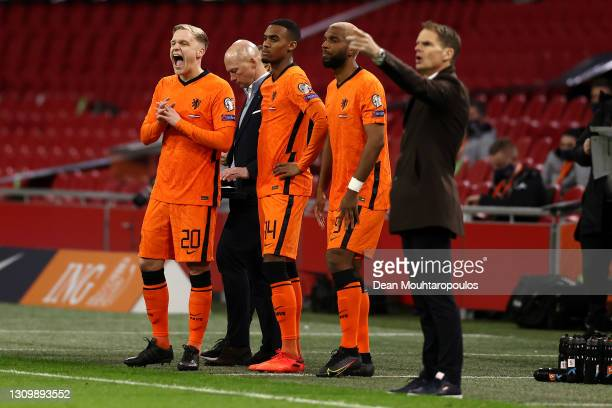 Head Coach / Manager of Netherlands, Frank de Boer gives his players instructions from the sidelines as substitutes Donny van de Beek, Ryan...