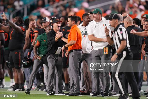 Head Coach Manny Diaz of the Miami Hurricanes celebrates with the assistant coaches after defeating North Carolina State Wolfpack by score of 31-30...