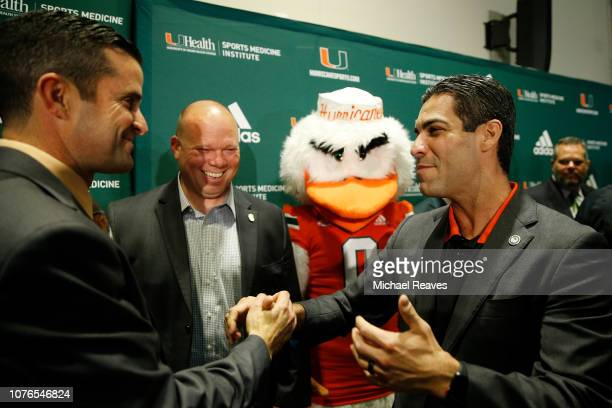 Head coach Manny Diaz of the Miami Hurricanes is greeted by Miami Mayor Francis Suarez after the introductory press conference in the Mann Auditorium...