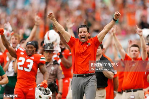 Head coach Manny Diaz of the Miami Hurricanes reacts after a touchdown against the Virginia Tech Hokies during the first half at Hard Rock Stadium on...