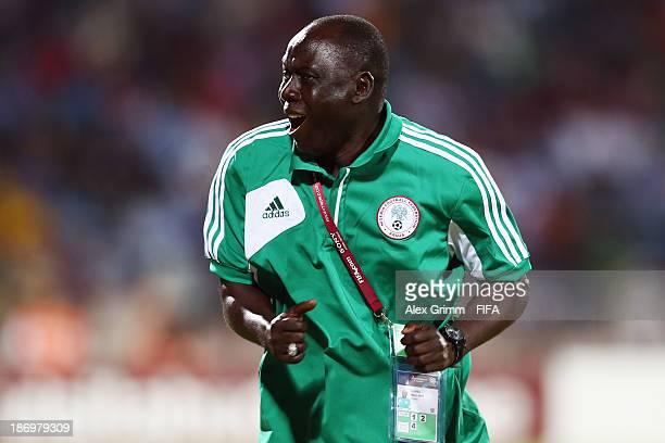 Head coach Manu Garba of Nigeria celebrates after Samuel Okon scored his team's second goal during the FIFA U-17 World Cup UAE 2013 Semi Final match...