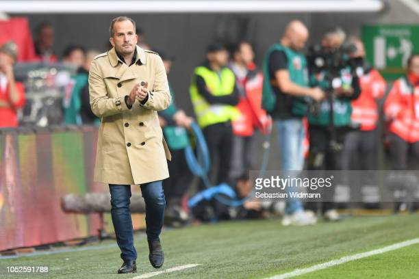 Head coach Manuel Baum of Augsburg gestures during the Bundesliga match between FC Augsburg and RB Leipzig at WWK-Arena on October 20, 2018 in...