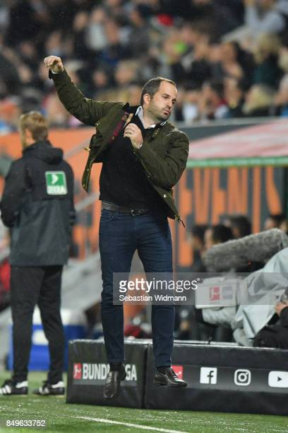 Head coach Manuel Baum of Augsburg gestures during the Bundesliga match between FC Augsburg and RB Leipzig at WWK-Arena on September 19, 2017 in...