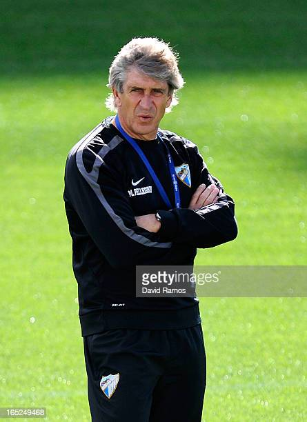Head coach Manuel Pellegrini of Malaga CF looks on during a traning session ahead of their UEFA Champions League quarterfinal first leg match against...