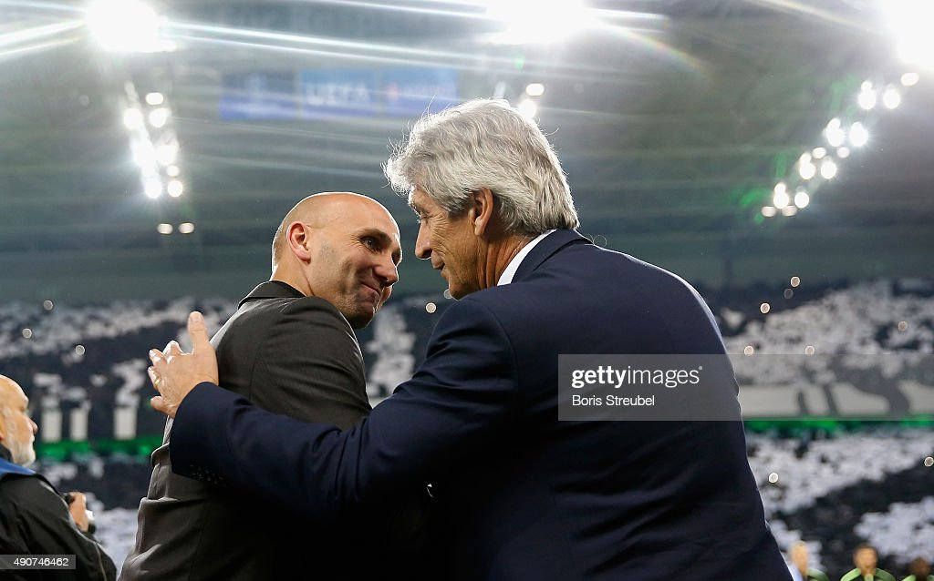Head coach Manuel Pellegrini (R) of Manchester City shake hands with Andre Schubert, head coach of Borussia Monchengladbach prior to the UEFA Champions League Group D match between VfL Borussia Monchengladbach and Manchester City at the Borussia Park on September 30, 2015 in Moenchengladbach, Germany.