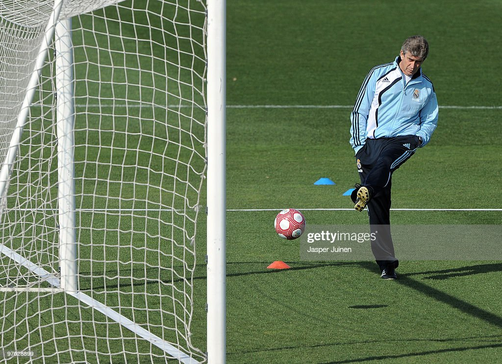 Head coach Manuel Pellegrini of Real Madrid shoots on goal during a training session, the day after Real Madrid's UEFA Champions League aggregate defeat against Lyon, at Valdebebas training ground on March 11, 2010 in Madrid, Spain.