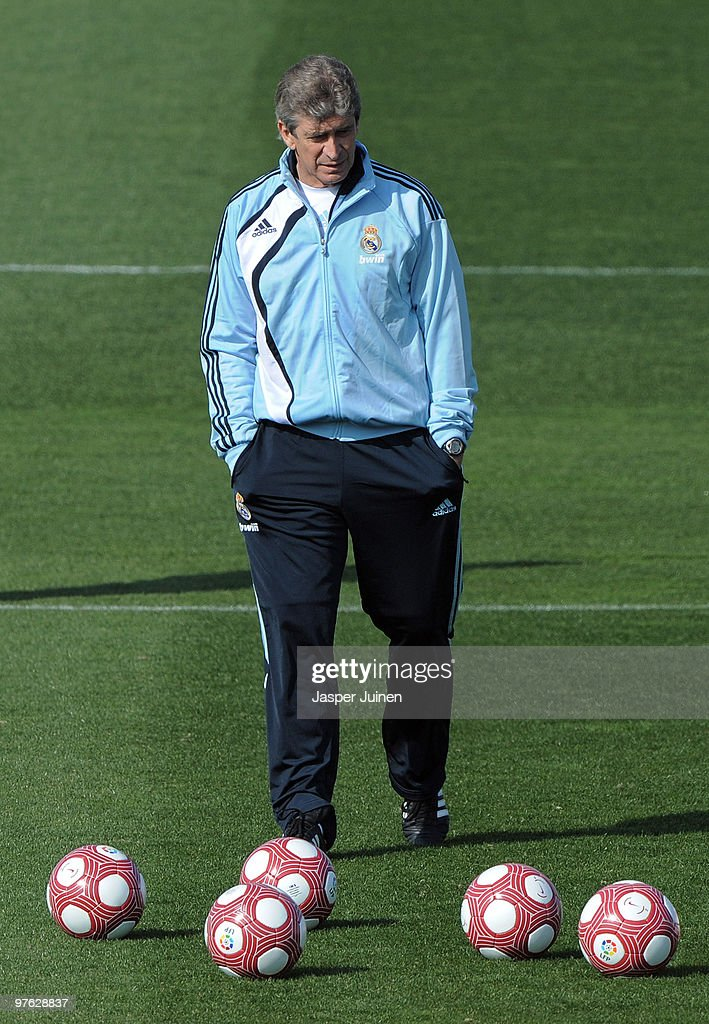 Head coach Manuel Pellegrini of Real Madrid trudges on the pitch during a training session, the day after Real Madrid's UEFA Champions League aggregate defeat against Lyon, at Valdebebas training ground on March 11, 2010 in Madrid, Spain.
