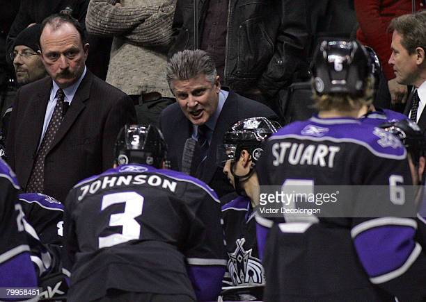 Head coach Marc Crawford of the Los Angeles Kings talks to this players as assistant coach Dave Lewis looks on prior to a faceoff with the Kings...