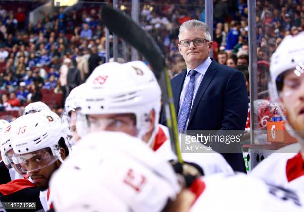 Head coach Marc Crawford of the Ottawa Senators looks on from the bench during their NHL game against the Vancouver Canucks at Rogers Arena March 20...