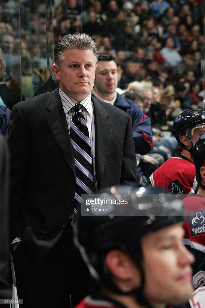 Head Coach Marc Crawford of the Vancouver Canucks looks on from the bench area during their NHL game against the Los Angeles Kings at General Motors Place on December 19, 2005 in Vancouver, British Columbia, Canada. The Kings defeated the Canucks 4-3 in shootout overtime.