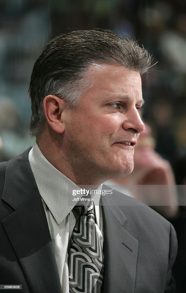 Head coach Marc Crawford of the Vancouver Canucks watches from the bench during the NHL game against the Dallas Stars at General Motors Place on October 16, 2005 in Vancouver, Canada. The Canucks defeated the Stars 5-2.