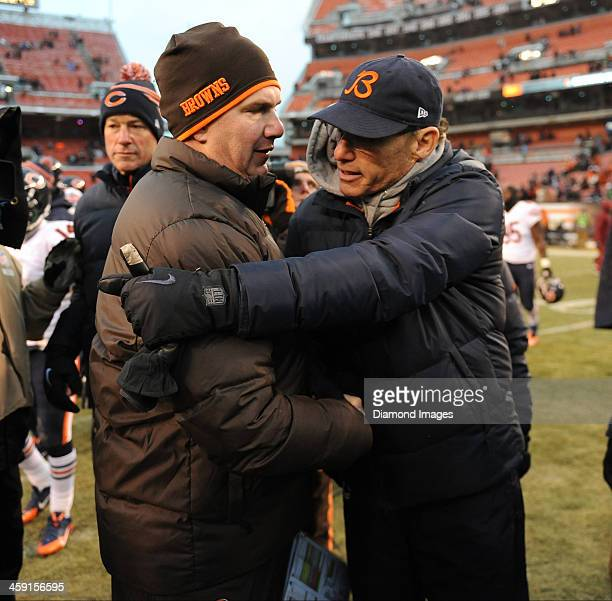 Head coach Marc Trestman of the Chicago Bears and head coach Rob Chudzinski of the Cleveland Browns shake hands after a game between the Cleveland...