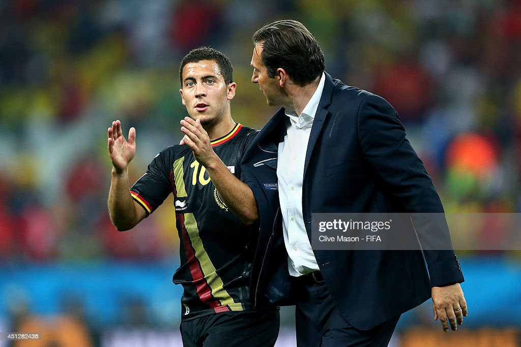 Head coach Marc Wilmots and Eden Hazard of Belgium celebrate the 1-0 win after the 2014 FIFA World Cup Brazil Group H match between Korea Republic and Belgium at Arena de Sao Paulo on June 26, 2014 in Sao Paulo, Brazil.