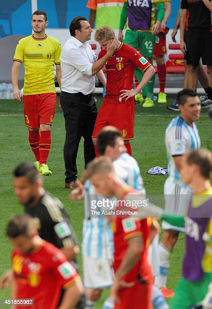 Head coach Marc Wilmots of Belgium consoles Kevin De Bruyne after the defeat in the 2014 FIFA World Cup Brazil Quarter Final match between Argentina...