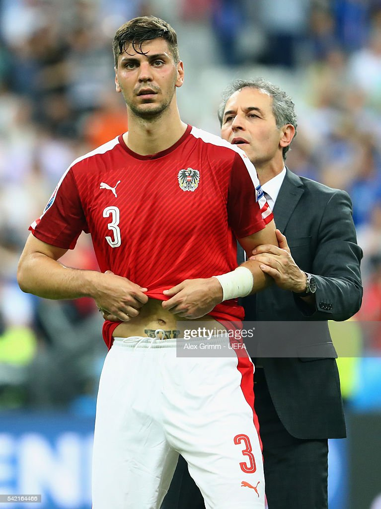 Head coach Marcel Koller of Austria consoles Aleksandar Dragovic after the UEFA EURO 2016 Group F match between Iceland and Austria at Stade de France on June 22, 2016 in Paris, France.