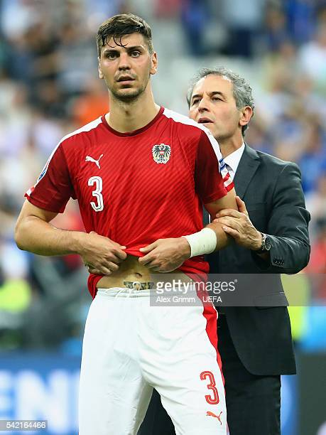 Head coach Marcel Koller of Austria consoles Aleksandar Dragovic after the UEFA EURO 2016 Group F match between Iceland and Austria at Stade de...
