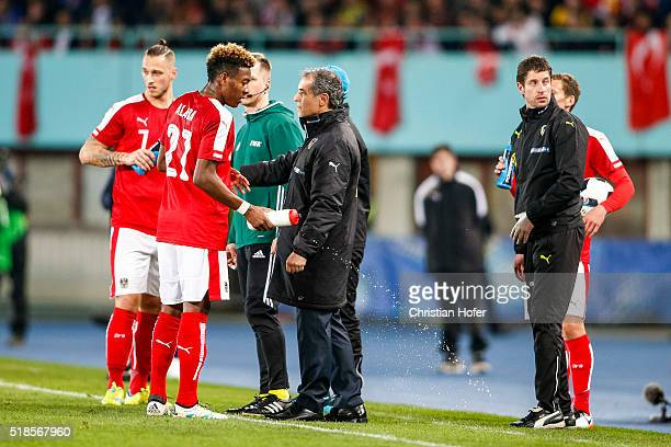 Head coach Marcel Koller of Austria instructs his players Marko Arnautovic and David Alaba during the international friendly match between Austria...