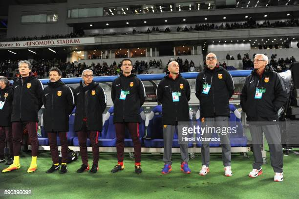 Head coach Marcello Lippi and China team staffs line up prior to the EAFF E1 Men's Football Championship between Japan and China at Ajinomoto Stadium...