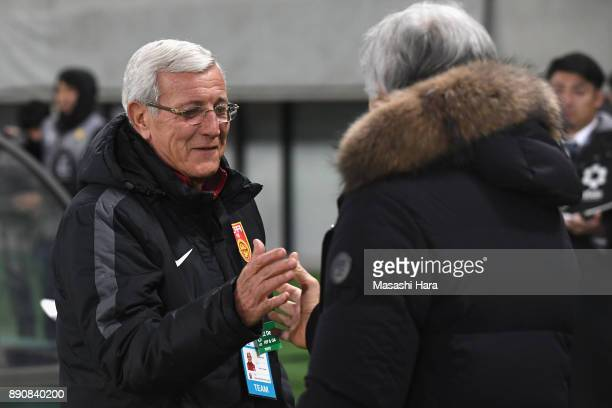Head coach Marcello Lippi of China and Head coach Vahid Halilhodzic of Japan shake hands prior to the EAFF E1 Men's Football Championship between...