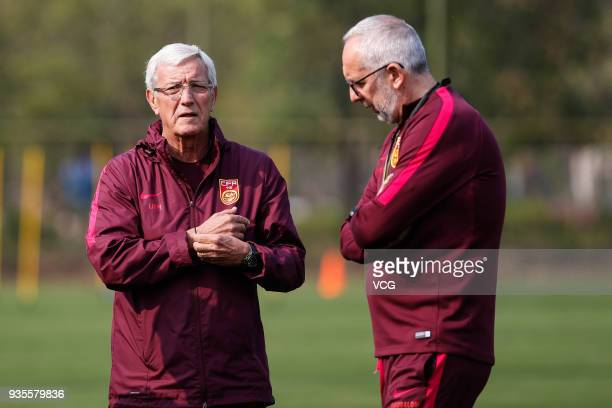 Head coach Marcello Lippi of China and his assistant Maddaloni Massimiliano attend a training session ahead of the 2018 China Cup International...