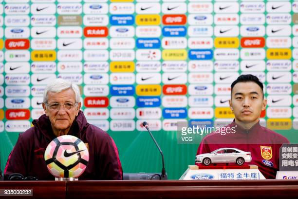 Head coach Marcello Lippi of China and his player Feng Xiaoting attend a press conference ahead of the 2018 China Cup International Football...