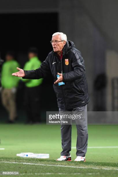 Head coach Marcello Lippi of China gestures during the EAFF E1 Men's Football Championship between Japan and China at Ajinomoto Stadium on December...