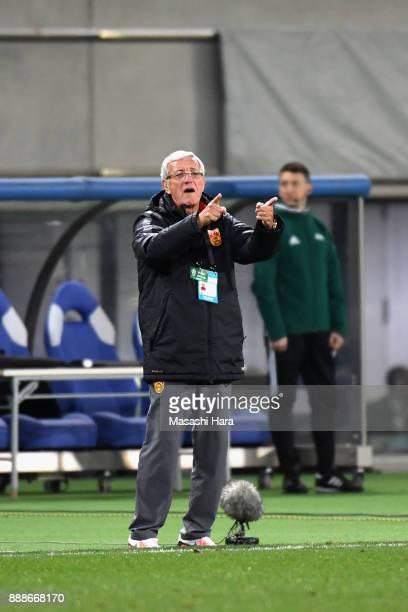 Head coach Marcello Lippi of China gives instruction during the EAFF E1 Men's Football Championship between South Korea and China at Ajinomoto...