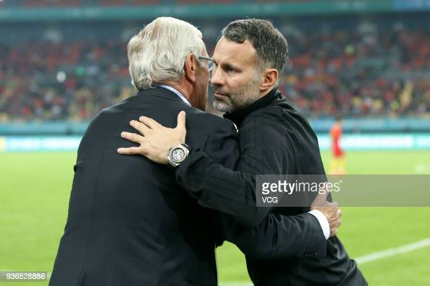 Head coach Marcello Lippi of China hugs head coach Ryan Giggs of Wales after the 2018 China Cup International Football Championship match between...