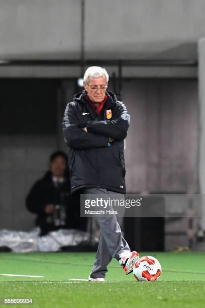 Head coach Marcello Lippi of China kicks the ball during the EAFF E1 Men's Football Championship between South Korea and China at Ajinomoto Stadium...