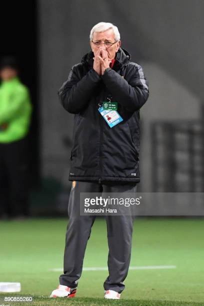 Head coach Marcello Lippi of China looks on during the EAFF E1 Men's Football Championship between Japan and China at Ajinomoto Stadium on December...