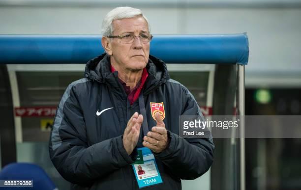 Head coach Marcello Lippi of China looks on prior to the EAFF E1 Men's Football Championship between South Korea and China at Ajinomoto Stadium on...