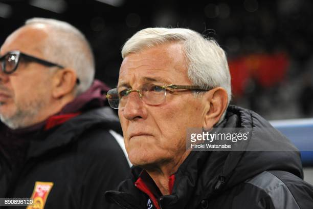 Head coach Marcello Lippi of China looks on prior to the EAFF E1 Men's Football Championship between Japan and China at Ajinomoto Stadium on December...