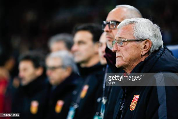 Head coach Marcello Lippi of China reacts prior to the EAFF E1 Men's Football Championship between Japan and China at Ajinomoto Stadium on December...