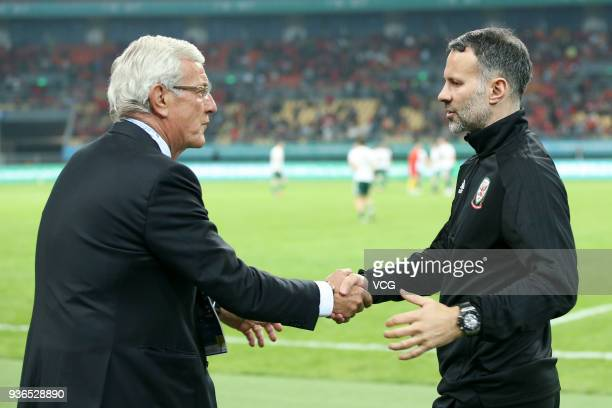 Head coach Marcello Lippi of China shakes hands with head coach Ryan Giggs of Wales after the 2018 China Cup International Football Championship...