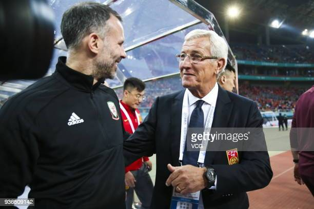 Head coach Marcello Lippi of China speaks with head coach Ryan Giggs of Wales prior to the 2018 China Cup International Football Championship match...