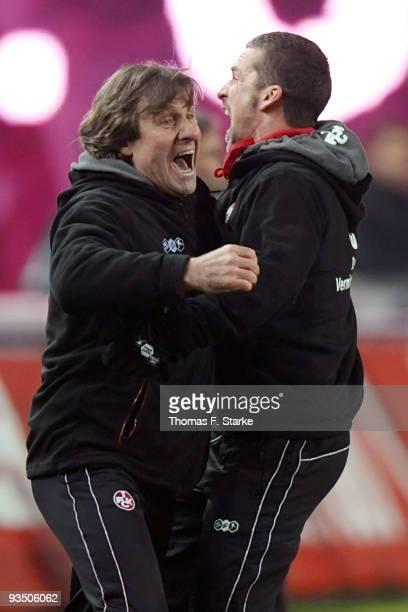 Head coach Marco Kurz and goalkeeper coach Gerald Ehrmann of Kaiserslautern celebrate after the Second Bundesliga match between 1 FC Kaiserslautern...