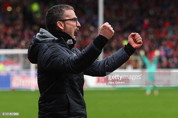 Head coach Marco Kurz of Duesseldorf celebrate after Sercan Sararer scored their team's second goal during the Second Bundesliga match between SC...
