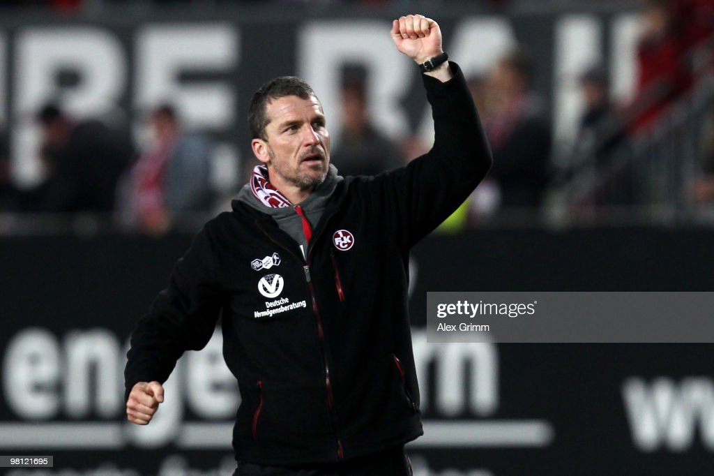 Head coach Marco Kurz of Kaiserslautern celebrates with supporters after the Second Bundesliga match between 1. FC Kaiserslautern and 1860 Muenchen at the Fritz-Walter Stadium on March 29, 2010 in Kaiserslautern, Germany.