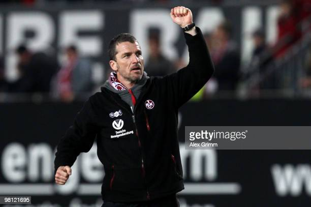 Head coach Marco Kurz of Kaiserslautern celebrates with supporters after the Second Bundesliga match between 1 FC Kaiserslautern and 1860 Muenchen at...
