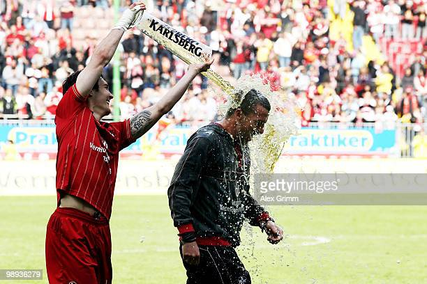 Head coach Marco Kurz of Kaiserslautern is showered with beer by Srdjan Lakic after the Second Bundesliga match between 1 FC Kaiserslautern and FC...