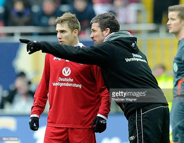 Head coach Marco Kurz of Kaiserslautern talks with Erik Jendrisek during the Second Bundesliga match between 1FC Kaiserslautern and SC Paderborn at...