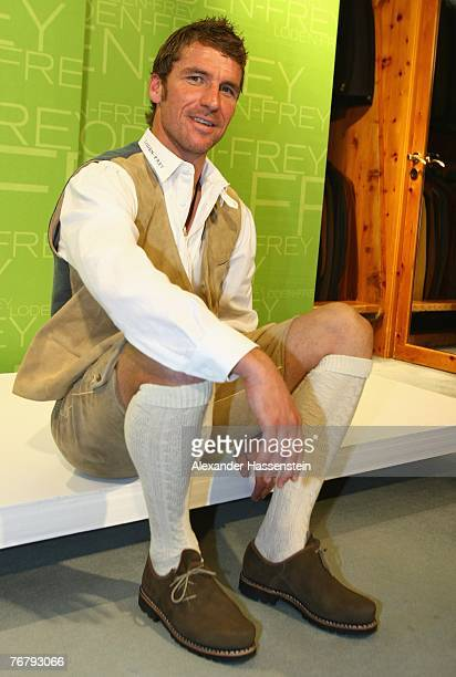 Head coach Marco Kurz of TSV 1860 Munich is seen while fitting a traditional Bavarian Lederhose costume at the LodenFrey costume shop on September 17...