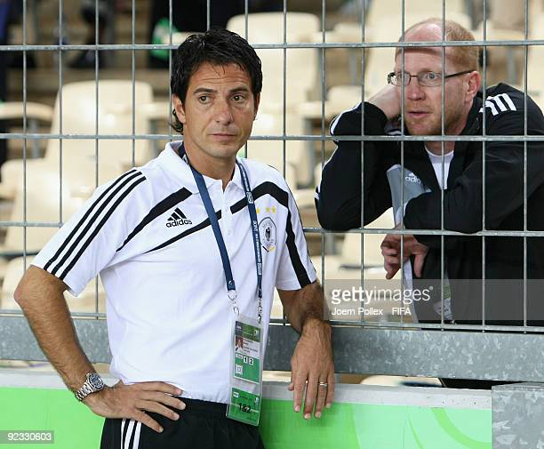 Head coach Marco Pezzaiuoli of Germany and Matthias Sammersporting director of the German Football Association DFB are seen prior to the FIFA U17...